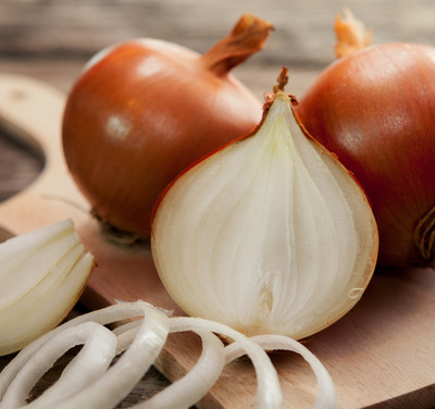 Fresh healthy onions on chopping board